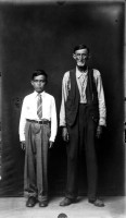 http://www.bernalespacio.com/files/gimgs/th-47_MikeDisfarmer From the Heber Springs Portraits (man and boy with arms at sides) 1940s.jpg